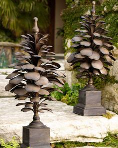 "Artistic interpretation of a pine cone. Handcrafted of metal. Hand-painted, antiqued aged ivory finish with burnished details; no two are exactly alike. Sold individually; each, 16""Dia. x 39.5""T. Impo"