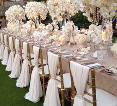 Beautiful chair covers and stunning arrangements. Gold and white.
