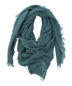 Warm up a transitional outfit with this cozy scarf. Strategically frayed hems create a raw and carefree look.
