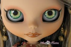 blythe doll-im not crazy about her lip color but her hazel eye chip color is really fantastic.