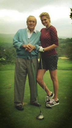 Kate Upton out on the links for a golf lesson with none other than Arnold Palmer.