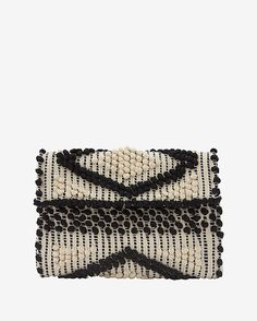 Antonello Foldover Cotton Clutch: Black/White: The handwoven cotton loom lends this classic clutch shape a unique craftsmanship along with its functionality. Braided shoulder strap. Foldover magnetic closure flap. Internal pocket. Measures: 12 by 8 . Lined. In black/white. Handmade in ...
