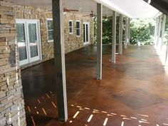 Instead of building a deck, you can stain your concrete patio for a low price.