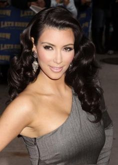 """""""The Old Hollywood Look""""  Future bridal hair idea.   It has a deep side part with larger  """"S"""" shape curls. Typically one side opposite of the part is pinned back behind the ear."""