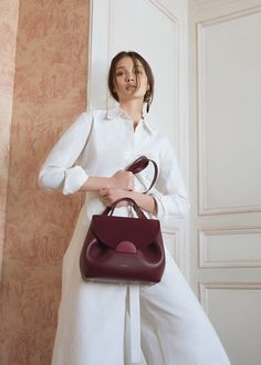 """Undeniably feminine for its sensual curves, """"Number One"""" is Polène's signature handbag. Designed as a day bag, you'll love its elegant yet easy-going style. Bordeaux, Polene Paris, S Signature, Day Bag, Number One, Fashion Bags, Burgundy, Pouch, Tulum"""