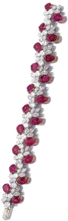Ruby and diamond bracelet Designed as undulating line of brilliant-cut and marquise-shaped diamonds embellished with oval rubies, mounted in yellow gold and platinum, length approximately 165mm, numbered, French assay and maker's marks. Sotheby's.