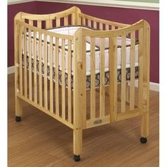 For grandma and grandpa house! Orbelle Trading Tian 2 in 1 Portable Crib in Natural