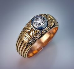 A Vintage Diamond Solitaire Carved Gold Men's Ring made in Moscow between 1908 and 1917 The design of this unique Russian Imperial era greenish yellow gold
