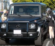 Kylie Jenner and her friend Pia Mia Perez were dwarfed by the monster SUV as they left Fred Segal