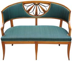 Barrel-back settee (for freestanding) in exceptional detailed quality (part of a suite). Walnut frame. Channeled rail and saber legs. Padded seat and padded seatback with green horsehair cover. Geometric designed radial pierced umbrella motif, parcel ebonized with fine detailed brass rosette. Vienna, before 1825.