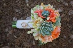 this is such a unique and beautiful bouguet! And may I just point out that the blue flowers are actually succulants!! How creative! A wedding bouquet with a strain of cactus! I love it!!! Plus the colors are just so fun and bright it makes me happy looking at it :) wedding-bliss