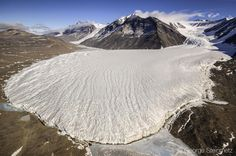 Photograph by George Steinmetz @geosteinmetz/@thephotosociety Canada Glacier where it meets Lake Fryxell. This is a cold base glacier with its base frozen onto the underlying rock. Cold base glaciers flow much more plastically and with less erosion than wet base glaciers that are found in temperate climates. To see more from Antarctica visit @geosteinmetz by natgeo
