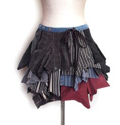 Caoutchouc skirt - Completely upcycled folding skirt, made of the collars of men's shirts and denim. The length of the shortest part is about 35 cm, the longest part about 45 cm. Low waist. 64.00 € http://www.kesidov.eu/skirts-shirts/suknja-kaucuk
