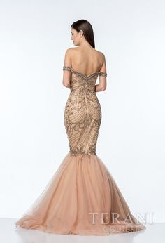 Glamorous+evening+gown+with+crystal+off-the-shoulder+neckline+and+Romanesque+embellishments+adorning+the+body+of+the+dress+and+ending+at+the+dramatic+tulle+mermaid+skirt