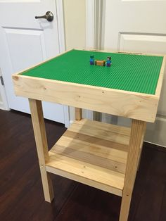 I made this entirely from pallet wood.  I would have used plywood for the top table if I had any to save time.  Lego base plates came from Toys R Us.