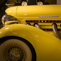 A 1935 yellow Auburn classic car, Auburn Cord Duesenberg Museum, in Auburn, Indiana