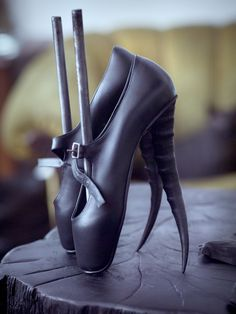 """michel berandi shoes.  I see mote and more of these crazy toe shoes. Is there a hord of ballerinas out there going on dates walking in """"street pointe""""?"""