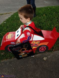 Megan: My son wanted to be lightening mcqueen. All the costumes were just race car suits so I decided to make him a real car to wear.he loved wearing the car...