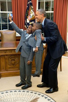 """Dec. 4, 2015 """"The President acquiesced to a selfie with 11-year-old Jacob Haynes and four-year-old James Haynes after taking a family photograph with departing White House staffer Heather Foster."""" (Official White House Photo by Pete Souza)"""