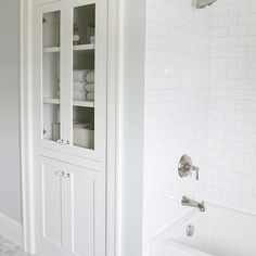 shower design with subway tile and marble tile niche Bathroom Linen Cabinets Storage Home Depot Linen Cabinets