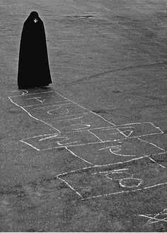 Possibilities: Woman in burkha (sp?) or Death playing hopscotch (you know, from that Ingmar Bergman movie?)