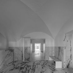 Tapestry Museum by CVDB Arquitectos  features marble walls and vaulted ceilings