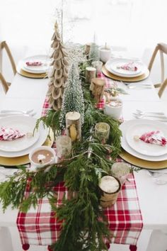 Beautiful table setting with little Christmas trees and hot cocoa