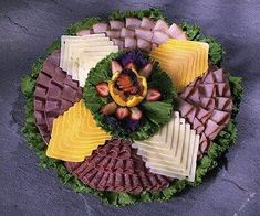 Sliced Meat and Cheese Party Tray from Joe's Produce One of our most popular party trays includes thin sliced ham, turkey, roast beef and hard salami accompanied by Swiss and American cheeses. Cheese Party Trays, Meat And Cheese Tray, Meat Trays, Meat Platter, Food Trays, Deli Platters, Deli Tray, Cheese Platters, Enjoy Your Meal