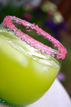 melon ball | 1oz Midori Melon Liqueur    .5oz Vodka    Pineapple Juice    Pour all into a rocks glass filled with ice and stir.  Garnish with pink sugar sprinkles if desired.