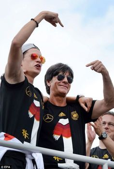 Manager Joachim Löw (pictured with Julian Draxler) told the crowd 'We're all world champio...