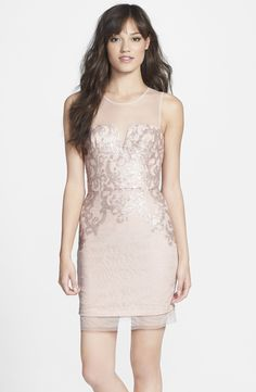 So pretty! Love this delicate embellished lace dress.