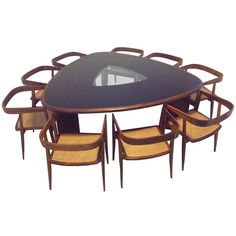 Rare Triangular Dining Table and Chairs by Joaquim Tenreiro | From a unique collection of antique and modern dining room tables at http://www.1stdibs.com/furniture/tables/dining-room-tables/