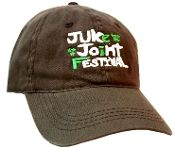 Juke Joint Festival Cap - Clarksdale, MS in brown with embroidery. The cap is fully adjustable to fit anyone with a buckle closure and is in mint condition. The cap is from the blues festival by the same name held in Clarksdale, MS.