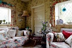 The comfortable and cosy sitting room (with pretty Sanderson slipcovers!) of Shaun Clarkson and Paul Brewster's renovated Victorian cottage.