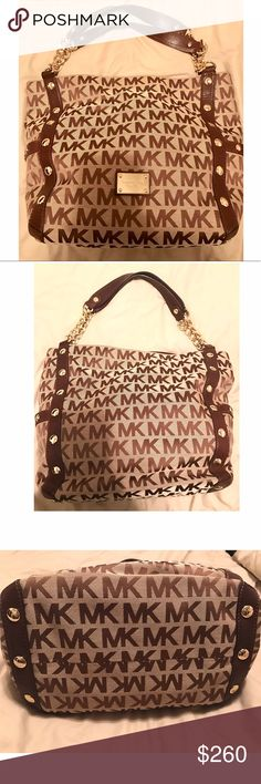 "Michael Kors Large Chain Handbag Bag Purse Tote In Excellent condition Michael Kors women's bag. Color is brown and beige. Handle is a thick gold tone chain  and brown leather. Monogrammed all around with MK. Round gold studs detailed around the purse as shown. Two side pockets. Inside back has button closure. One wall lining pocket with zipper closure and 4 open wall lining pockets. Great for any ocassion.comes with dust cover. Dimensions are 15w x 14L x 8d. Handle is about 10"" drop…"