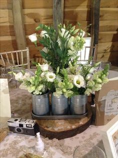 Table Centre containing all white Lisianthus, Antirrhinums, Gyp and Foliage #WeddingFlowers #TableCentre #White