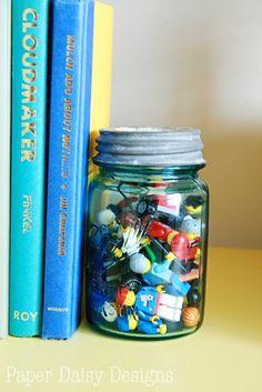 When the kid outgrows the toys (LEGOS), keep pieces in a jar as a memento/decor/bookend