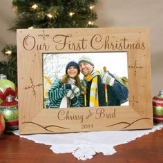 """Our First Christmas Personalized Wood Picture Frames. Your First Christmas together is something to cherish for a lifetime. Create a lasting Personalized First Christmas Keepsake to hold your favorite Christmas photo to enjoy long after Christmas has passed. Our Personalized First Christmas Picture Frame measures 8¾"""" x 6¾"""" and holds a 3½"""" x 5"""" or 4"""" x 6"""" photo. Easel back allows for desk display."""