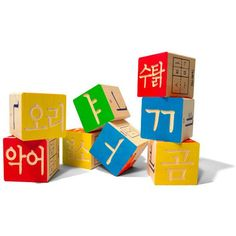 "Say ""An Nyoung"" to this great set of Korean Alphabet Blocks designed to help your little one develop language skills as she builds. This hand-crafted set of 32 wooden blocks features Korean language s"