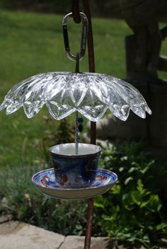 Vintage cup and saucer, hanging bird feeder by CranberryAcre on Etsy – Crafts Beauty Bird Feeder Plans, Bird House Feeder, Hanging Bird Feeders, Diy Bird Feeder, Teacup Bird Feeders, Bird Crafts, Garden Crafts, Teacup Crafts, Glass Garden Art