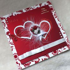 A luxury handmade Ruby Wedding Anniversary card, this exquisite card is large at square. The main centre piece is two entwined loving hearts, embellished with roses and red glitter butterfly, on deep red satin card, backed onto red floc. Wedding Cards Handmade, Greeting Cards Handmade, Ruby Wedding Anniversary, Romantic Cards, Engagement Cards, Valentine Day Cards, Making Ideas, Cardmaking, Birthday Cards