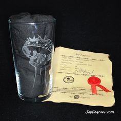 This glass engraving is a tribute to HBO's TV Series Game Of Thrones. This pint glass is hand engraved with the Game Of Thrones crown. This glass engraving was done Glass Engraving, Hand Engraving, Hbo Tv Series, Game Of Thrones Fans, Pint Glass, Initials, Birthday Gifts, Crown, Glasses