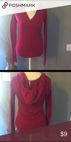 American Eagle Hooded Sweater Great condition. Two holes at the very bottom for a string missing as pictured. I never wore it with one American Eagle Outfitters Sweaters V-Necks