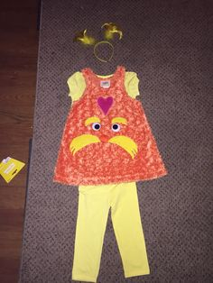 Homemade lorax tshirt made from felt fabric pieces cut to shape diy lorax girls costume solutioingenieria Image collections