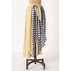 Brand new, never worn, asymmetric skirt Brand new, yellow and blue asymmetric skirt with bent lines. From anthropologie. Cute for spring and summer with a tucked in white tee or tank or a crop top. Anthropologie Skirts Asymmetrical