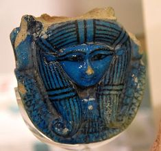 Hathor's head. Faience, from a sistrum's handle. 18th Dynasty. From Thebes, Egypt. The Petrie Museum of Egyptian Archaeology, London