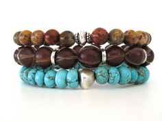 Bohemian beaded stretch bracelets featuring 8mm turquoise magnesite rondelle beads, 8mm petrified wood jasper beads, 10mm brown buri seed beads and pewter accent beads. Such a cool handmade bracelet stack that can be worn as shown or individually for a more simple statement. The turquoise magnesite beads add the perfect pop of color making this the perfect accessory for any Boho chic outfit.