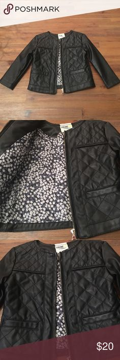 Adorable Black Pleather Jacket In perfect condition. Size 18 months. Black on the outside. Long sleeve jacket. Black and white floral print on the inside. Zipper on the front with two front pockets. 100% polyester on the inside and outside. True to size. 10 inches across chest and 13 inches in length. Genuine Kid from OshKosh brand. Osh Kosh Jackets & Coats