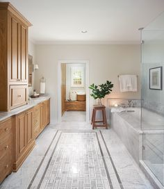 I used all marble tile in this bathroom. To break it up and add in a little interest, we laid smaller marble tiles in a rug pattern in the center of the room. The result is almost spa-like.