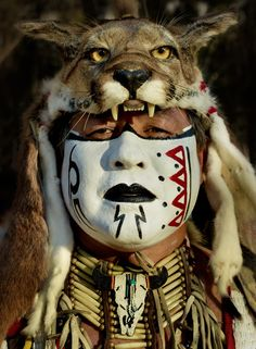 Native American Pow Wow dancer with a mountain Lion Headdress in the Silicon Valley, Ca. May 2012
